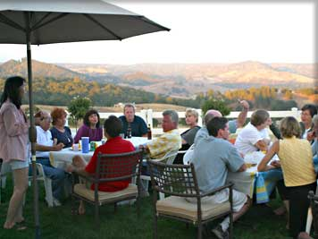 Residents gather at a backyard get-together overlooking the Sierras